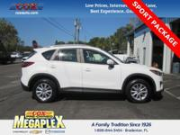 This 2014 Mazda CX-5 Sport in White is well equipped