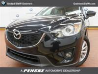 ======: This 2014 Mazda CX-5 Touring has a Jet Black