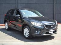 This 2014 Mazda CX-5 4dr FWD 4dr Automatic Touring