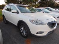 This outstanding example of a 2014 Mazda CX-9 Grand