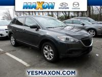 This outstanding example of a 2014 Mazda CX-9 Sport is