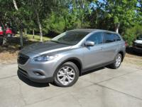 This 2014 Mazda CX-9 4dr FWD 4dr Sport features a 3.7L