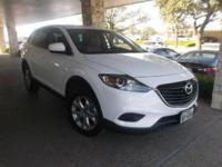 This 2014 Mazda CX-9 Touring is proudly offered by