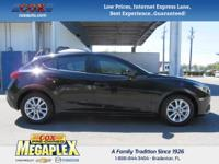 This 2014 Mazda Mazda3 i in Black is well equipped