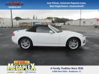 This 2014 Mazda Miata Sport in White is well equipped