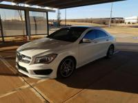 We are excited to offer this 2014 Mercedes-Benz