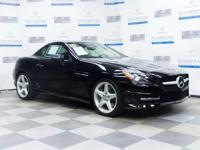 This 2014 Mercedes-Benz SLK-Class SLK250 is proudly