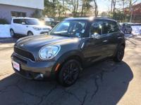 Solid and stately, this 2014 MINI Cooper Countryman is