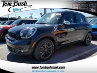 This outstanding example of a 2014 MINI Cooper