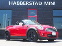 Bold and beautiful, this 2014 MINI Cooper Roadster 2DR