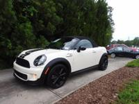 FUN CAR FOR SUMMER. MINI ROADSTER WITH LOW MILES, CLEAN
