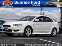 Meet our 2014 Mitsubishi Lancer SE AWC shown in