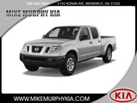 This 2014 Nissan Frontier is complete with top-features
