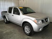 This 2014 Nissan Frontier comes equipped with heated
