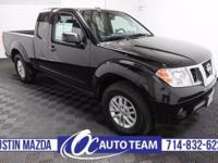 Sharp-looking in Super Black, our 2014 Nissan Frontier