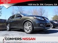 Come see this 2014 Nissan Rogue SL. Its Variable