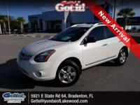 This 2014 Nissan Rogue Select S in Pearl White