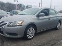 This 2014 Nissan Sentra SV has an exterior color of