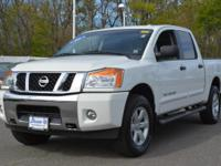 -        This 2014 Nissan Titan SV with 34,966 miles is