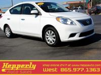 This 2014 Nissan Versa 1.6 S in Fresh Powder features.
