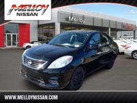 This outstanding example of a 2014 Nissan Versa SV is