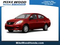 Come see this 2014 Nissan Versa SV. Its Variable