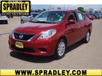 This impressive example of a 2014 Nissan Versa SV is