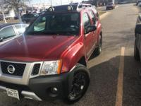 We are excited to offer this 2014 Nissan Xterra. When