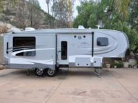 We **MUST SELL** our 2014 5th Wheel Open Range Roamer,