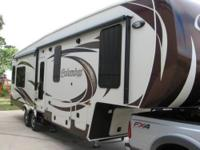 Columbus 295 RL is 35' long with rear living-room