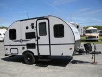 This Palomino PaloMini Lite travel trailer 142CK has