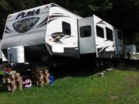 34 foot travel trailer with three sliders including a