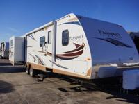 The 2014 Passport Grand Touring 3290BH is a travel