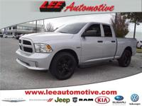 This 2014 RAM Tradesman/Express 4x4 Quad Cab 140 in. WB