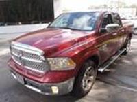 This 2014 Ram 1500 Laramie is proudly offered by