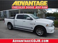 This WHITE 2014 RAM 1500 LARAMIE LIMITED is in GREAT
