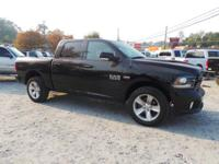 This 2014 RAM 1500 Sport features backup sensor, dual
