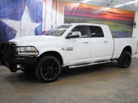 *Rule the roads in this bright white 2014 Ram 2500