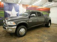 *Rule the roads in this massive gray 2014 Certified Ram