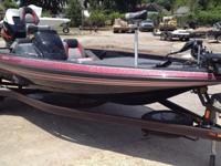 ,,,,,,,2014 Skeeter TZX195 bass boat powered by a