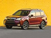 2014 Subaru Forester 2.5i Touring. Goof-proof controls.