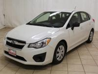 This 2014 Subaru Impreza wagon has just 26,100 miles on