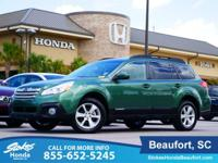 2014 Subaru Outback in Green. Stays the course.
