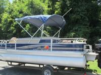 2014 Sun Tracker Fishin Barge 22 DLX with a 2014