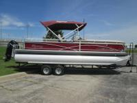 This is a 2014 Sun Tracker Regency 254 powered by a