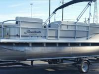 With Evinrude ETec 60 HP. custom trailer, Bimini top,