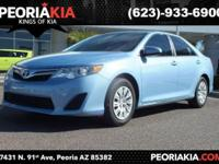 This is a 2014 Toyota Camry LE model with low mileage.
