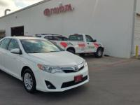 This 2014 Toyota Camry LE is proudly offered by Powell