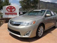 Cloth. CARFAX One-Owner. Clean CARFAX. Gold 2014 Toyota