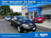 Corolla L. Classy Black! Terrific fuel efficiency!